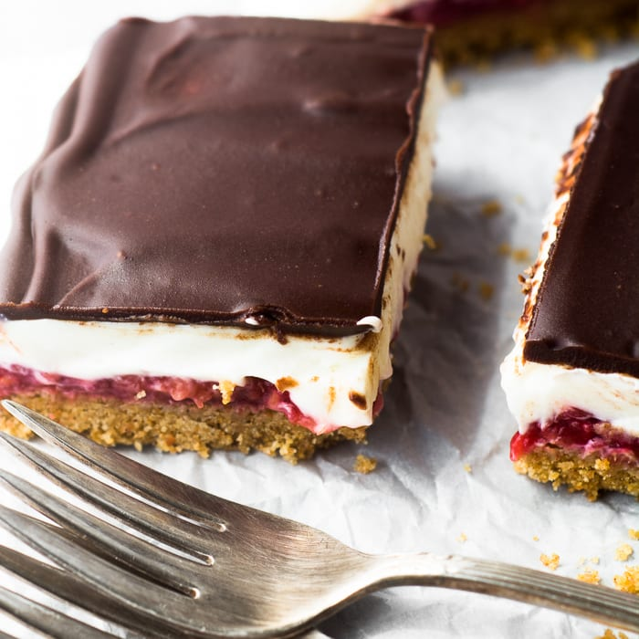 No Bake Raspberry Cheesecake Bars are great chilled or straight from the freezer! | theviewfromgreatisland.com