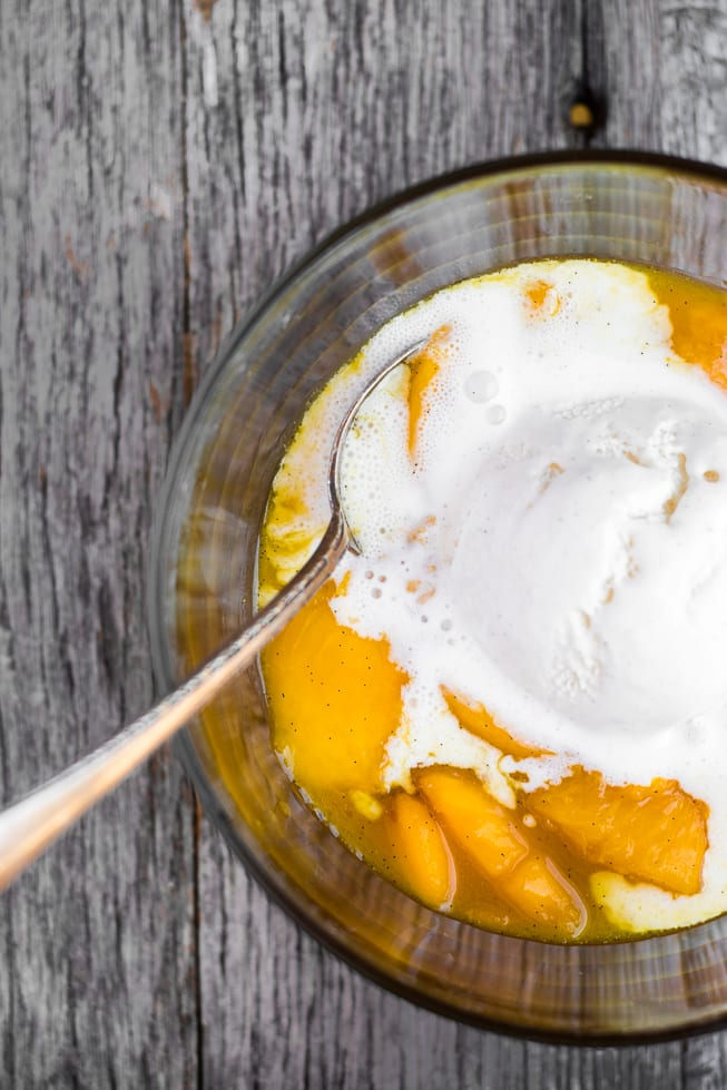 Bourbon Fried Peaches with Ice Cream ~ this super easy and super luscious dessert is the perfect way to close out the summer season --- and be sure to freeze some fresh peaches so you can enjoy it all year long! | theviewfromgreatisland.com