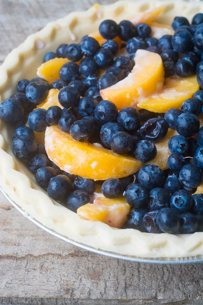 Blueberry Peach Crumble Pie is the easiest way to enjoy summer fruit for dessert! ~ theviewfromgreatisland.com