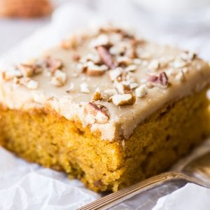 pumpkin cake with frosting and nuts