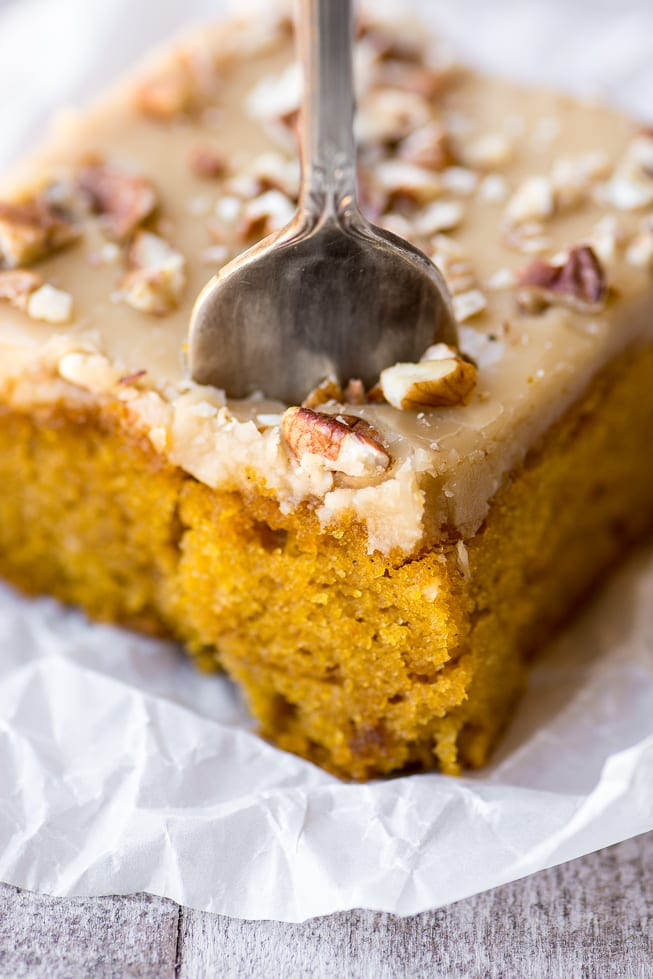a piece of pecan praline pumpkin cake with fork