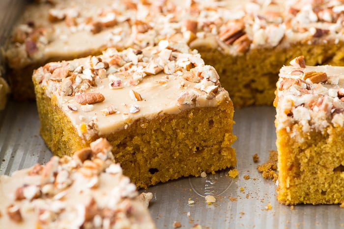 Praline Pumpkin Cake squares in a metal pan