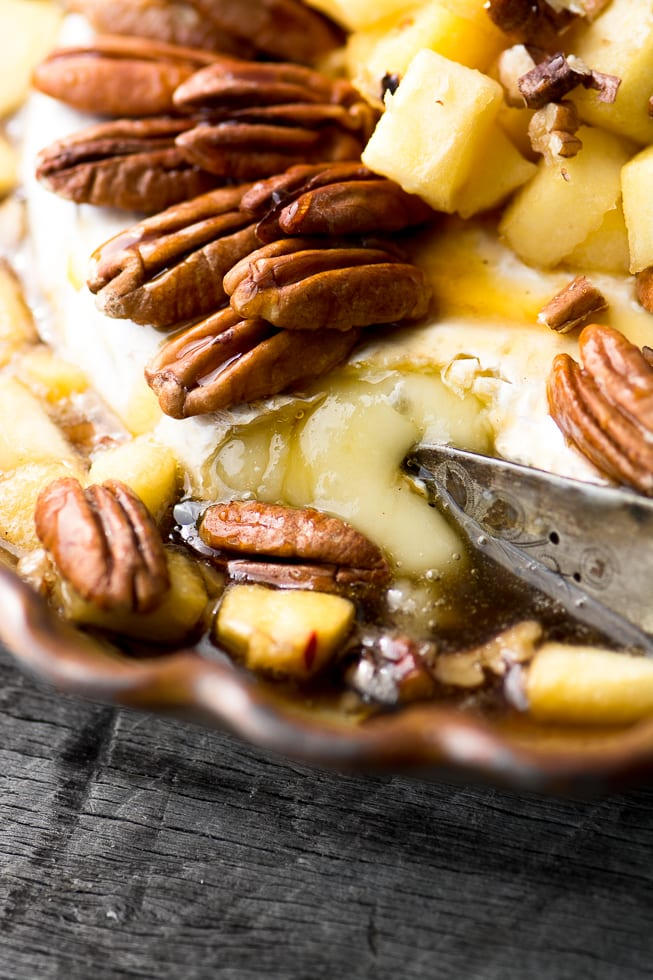 Baked Brie with Apples, Pecans, and Maple Syrup is a hot appetizer that will draw crowds! ~ theviewfromgreatisland.com