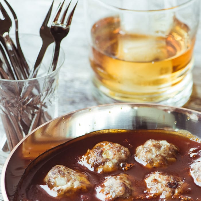 Delicious Bourbon Cocktail Meatballs are tender and light, and slatherd in a dreamy bourbon barbecue sauce! ~ theviewfromgreatisland.com