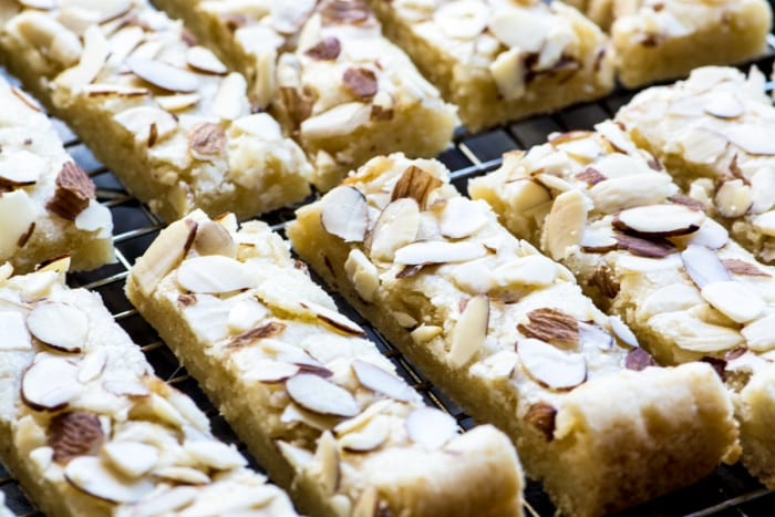 Buttery Scandinavian Almond Bars sliced and cooling on a rack