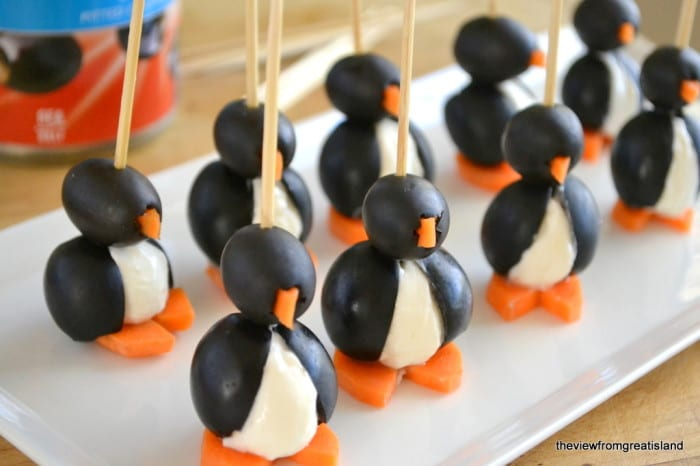 Olive cocktail penguins on a white platter