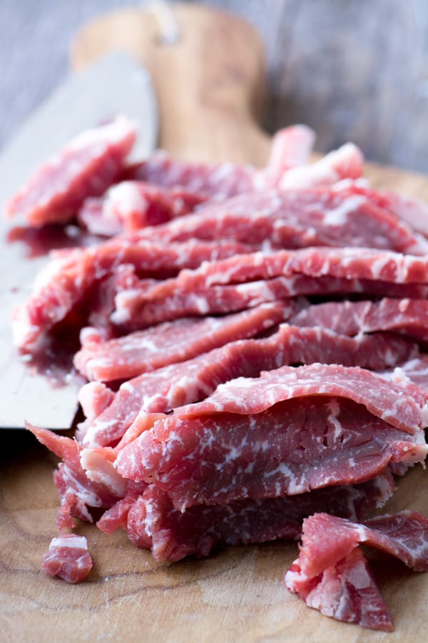 Thinly sliced raw steak for slow cooked weeknight pho ~ theviewfromgreatisland.com
