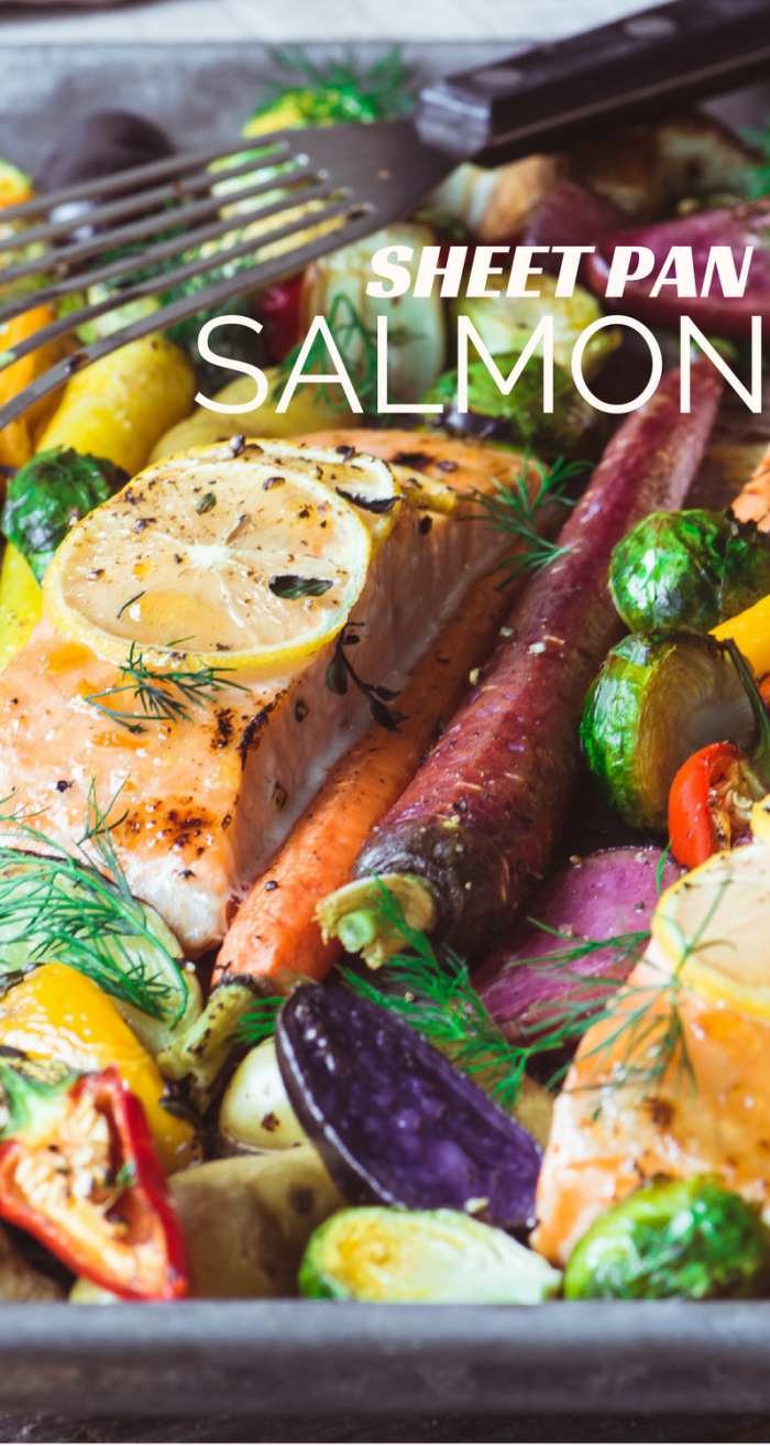 This quick and easy sheet pan salmon with caramelized vegetables is a simple and healthy one pan dinner that will get oohs and aahs from everybody at your table. #sheetpandinner #salmon #fish #healthydinner #easysalmon #salmonrecipe #onepotmeal #glutenfree @whole30 #paleo #rainbow #roastedvegetables #roastedsalmon