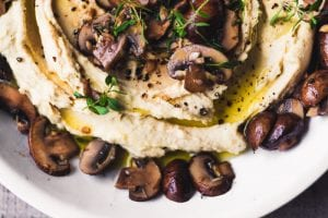Warm Hummus with Mushrooms ~ this is one of our favorite ways to do hummus ~ the sauteed mushrooms give this healthy appetizer a rich, meaty, almost decadent flavor. Add lots of toasted pita bread and you could call it dinner.