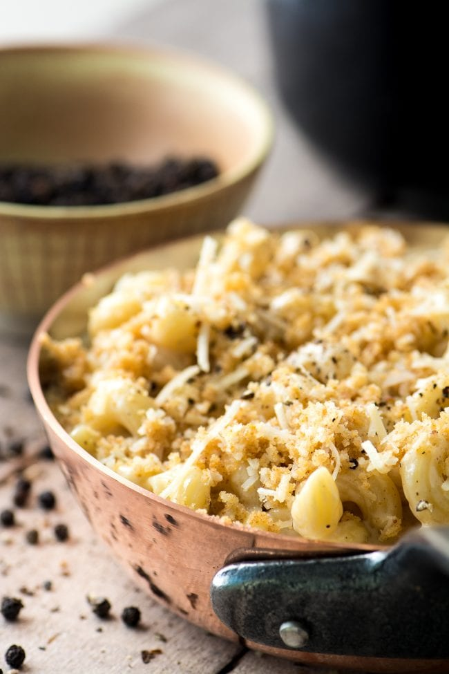 Baked Cacio e Pepe Macaroni and Cheese with a crisp breadcrumb topping.