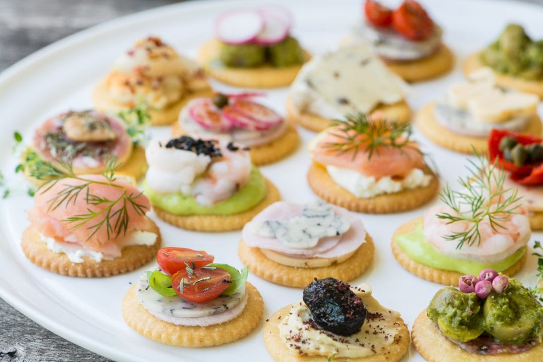 Easy Springtime RITZ Cracker Canapés ~ celebrate the return of warmer weather with a collection of colorful toppings on crisp Ritz crackers...layer them up and watch them disappear!