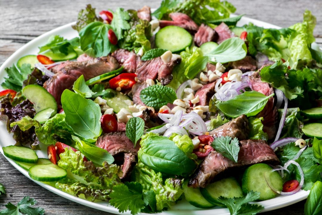 Thai Beef Salad, a tangy and spicy salad made with sliced steak, fresh herbs, and a spicy garlic and ginger dressing ~ theviewfromgreatisland.com