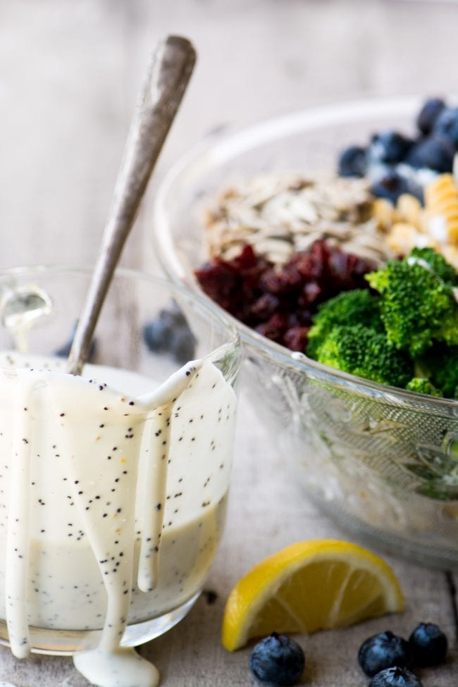 Dressing a colorful and gluten free Broccoli and Blueberry Pasta Salad with Lemon Buttermilk Dressing - Chickapea Pasta