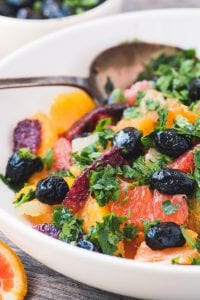 Spicy Mixed Citrus Salad ~ this bold Mediterranean fruit salad is packed with fresh parsley, studded with oil curred olives, and drenched in a spicy vinaigrette.
