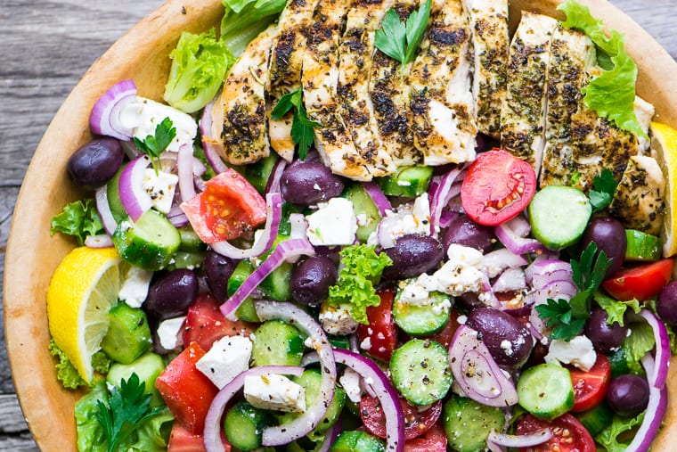 Vibrant Grilled Chicken Greek Salad in a wooden salad bowl