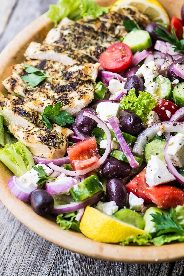 Grilled Chicken Greek Salad in a wooden bowl