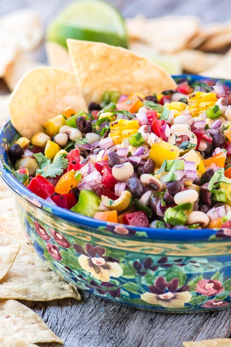 Cowboy Caviar with corn chips in a colorful bowl