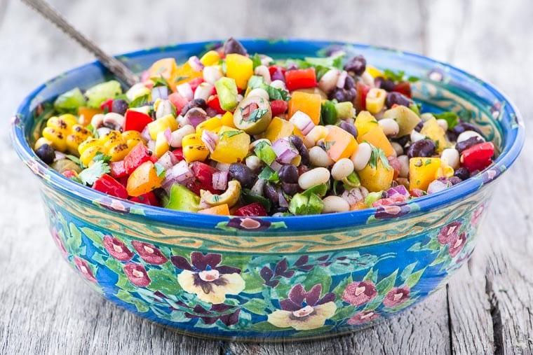 Cowboy Caviar ~ whether you call it Texas caviar, black bean salsa, blackeyed pea salad, or Southwestern bean salad, this all-American cross between a salsa and a salad is just plain GOOD! This multi-tasker is always welcome at barbecues and potlucks, and it has Cinco de Mayo, Memorial Day, and 4th of July written all over it.