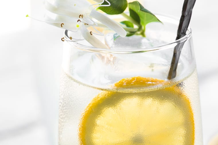Honeysuckle Vodka Lemonade ~ this uniquely refreshing spring cocktail is made with homemade honeysuckle infused vodka and fresh squeezed lemonade...| vodka | summer cocktail | infused alcohol | edible flowers | Mother's Day | spring cocktail | vodka |