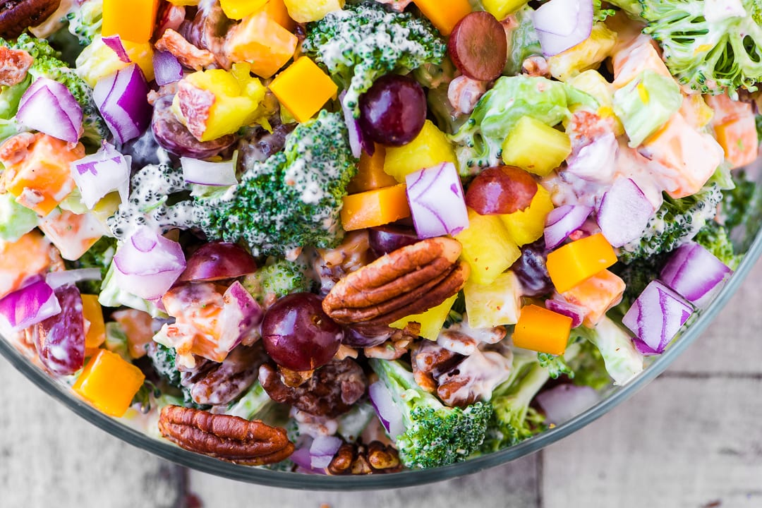 Broccoli Salad with Pineapple, Bacon and Spiced Pecans ~ don't be surprised if everybody skips the main course altogether and heads straight for this salad! This classic broccoli salad gets an extra burst of sweetness from fresh pineapple, and lots of crunch from bacon and chili rubbed pecans.