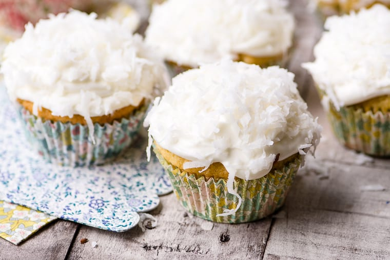 Ina Garten's Coconut Cupcakes ~ these easy-peasy tender coconutty cupcakes are topped with the most insanely delicious coconut cream cheese frosting ~ they're perfect for spring flings!