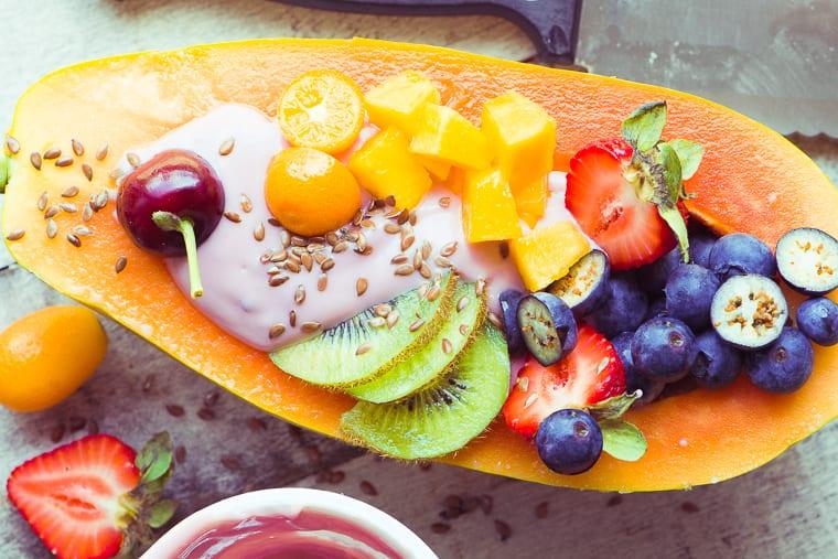 Papaya breakfast boat with yogurt and fruit