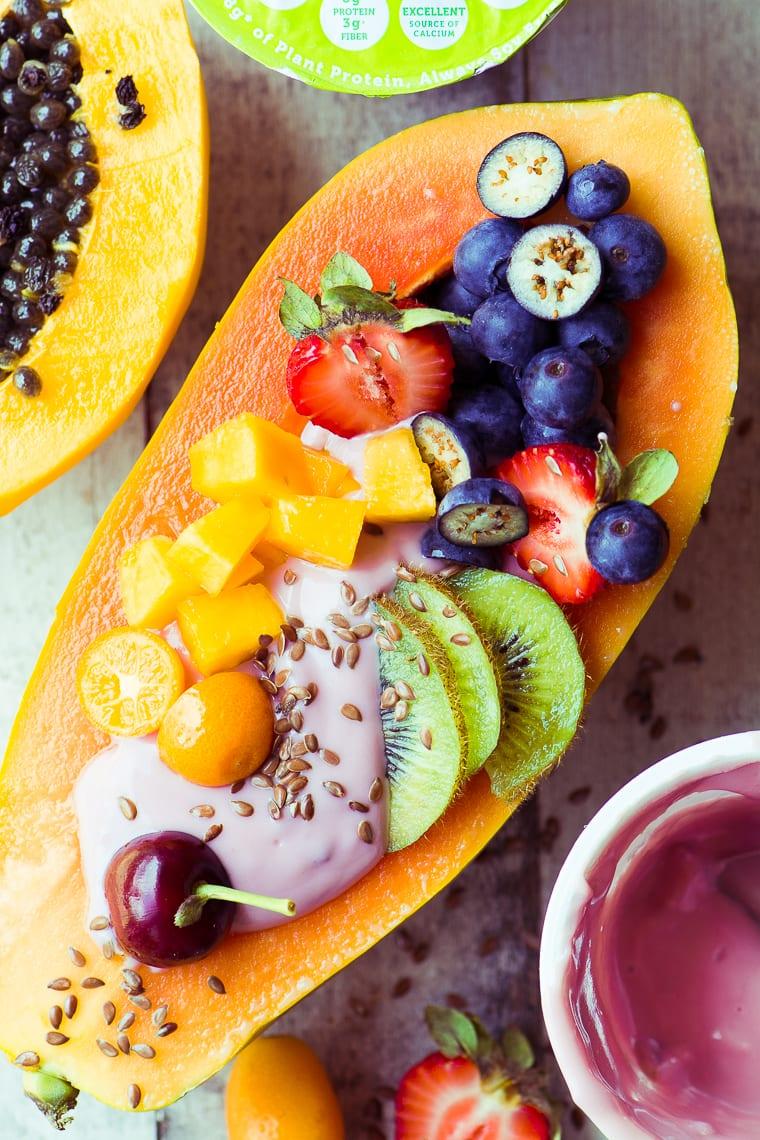 Papaya Breakfast Boats loaded with fresh fruit and yogurt