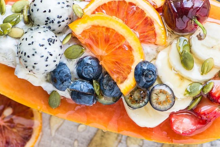 Papaya Breakfast Boat with fruit and honey