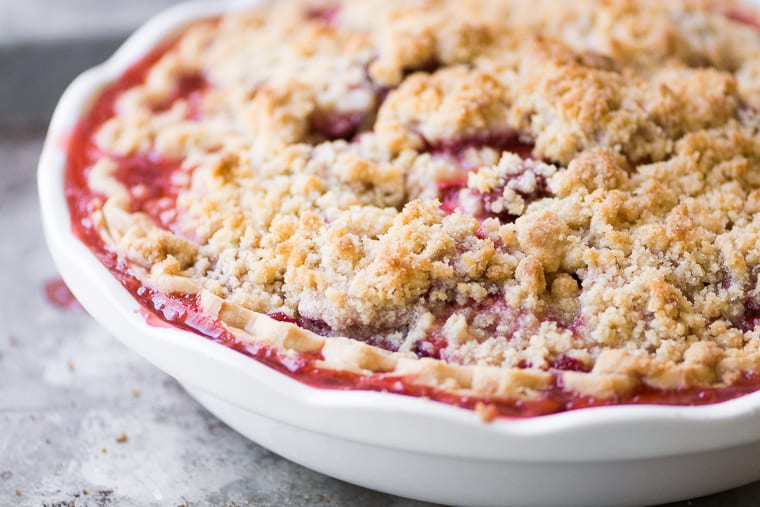 Strawberry Crumble Pie in a white pie plate