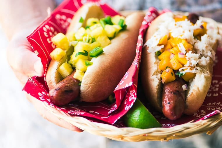 Hot dogs topped with tropical relishes and salsa