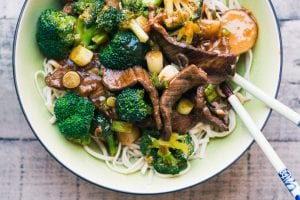 broccoli beef in a bowl with noodles