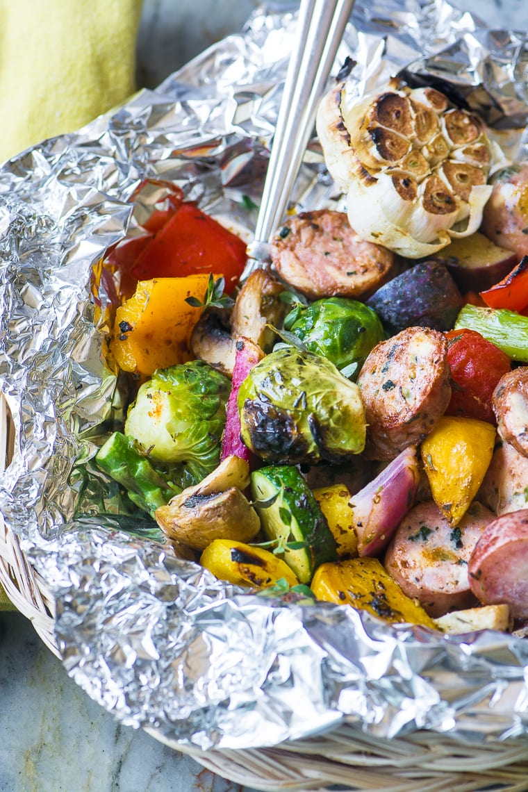 Sausage and Veggie Grill Packets ~ here's an easy idea for lazy summer nights...pile your sausage and cut veggies onto a sheet of foil, wrap it up, and throw it on the grill ~ dinner'll be ready in 30 minutes!
