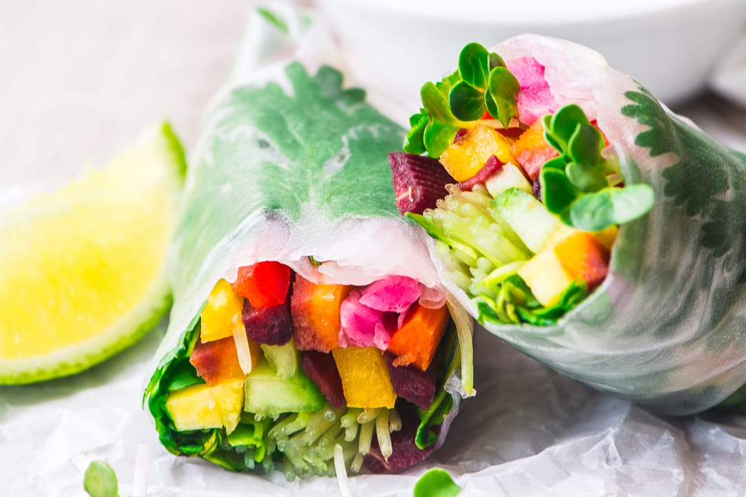 A rainbow summer roll, sliced in half