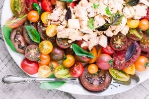 My Summer Tomato and Tuna Salad is in the Mediterranean tradition of serving up healthy seasonal food simply and There's no need for heavy sauces or dressings, these ingredients can stand on their own, with maybe a dousing of the best olive oil in the house.   main course salad   healthy dinner   seafood   fish   30 minute meal   whole 30   gluten free   paleo  