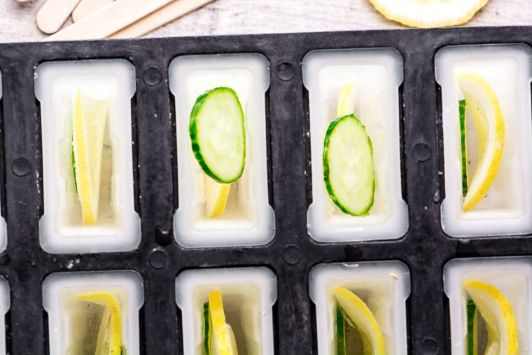 Overhead photo of cucumber lemon spa popsicles in popsicle molds.