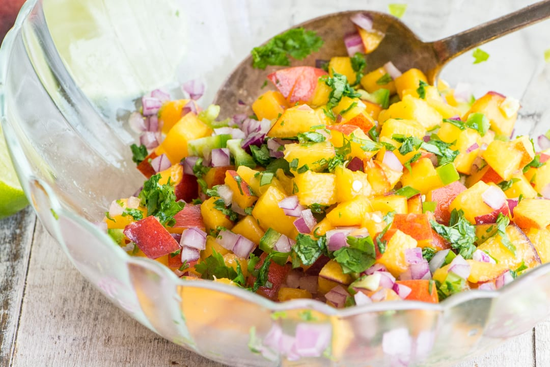 Peach Jalapeño Salsa in a bowl with spoon