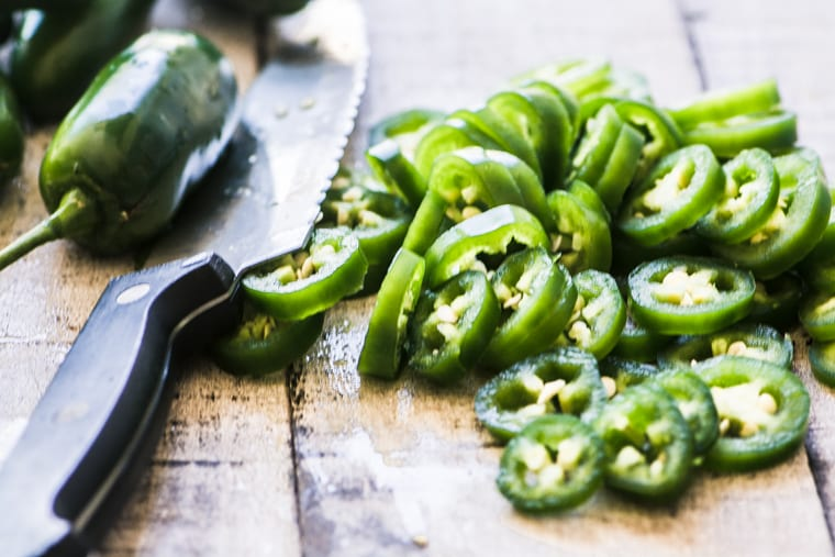 chopping jalapeño peppers