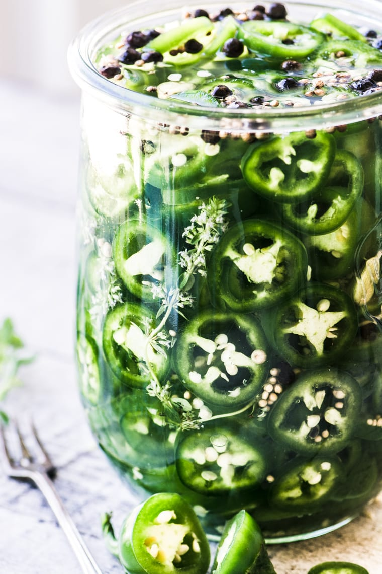 quick pickled jalapeños in a large jar