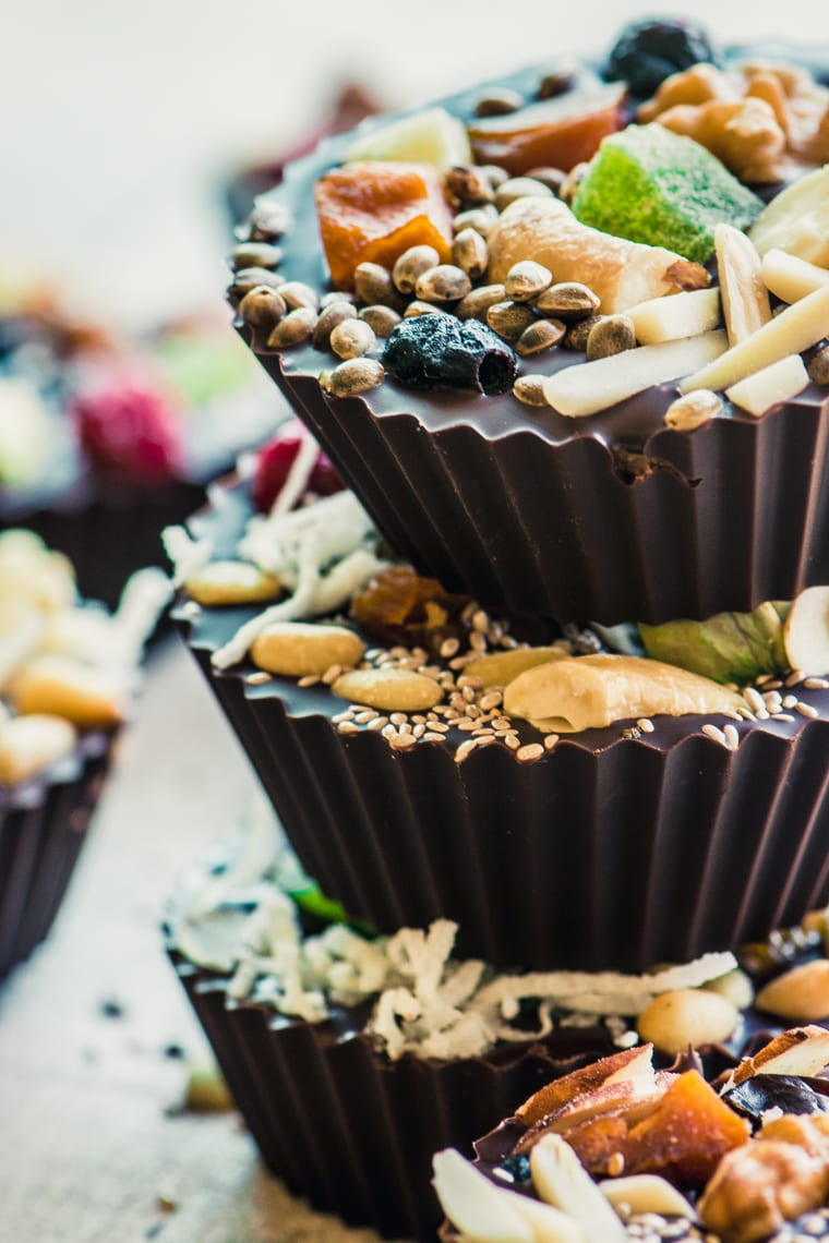 A colorful stack of Detox Dark Chocolate Almond Butter Cups