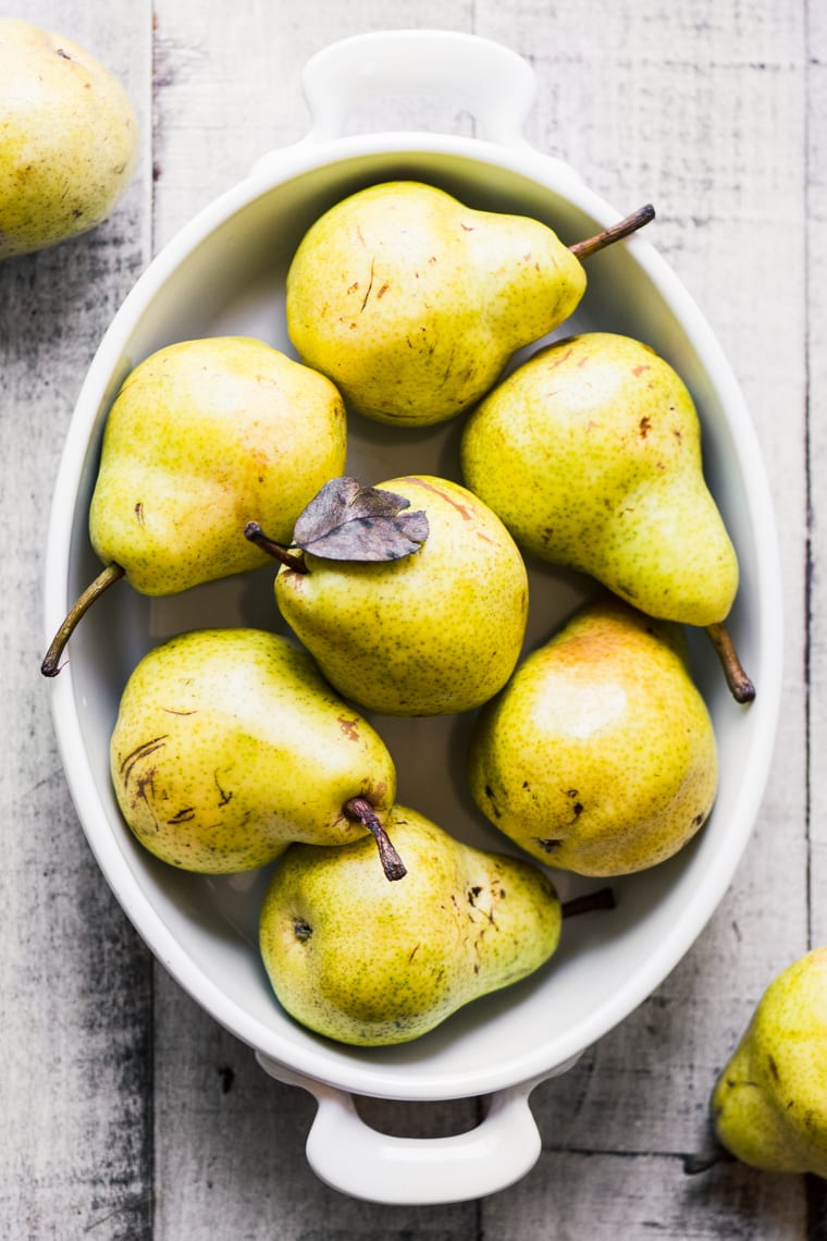 fresh pears arranged in a baking dish ready to be made into a pear crisp