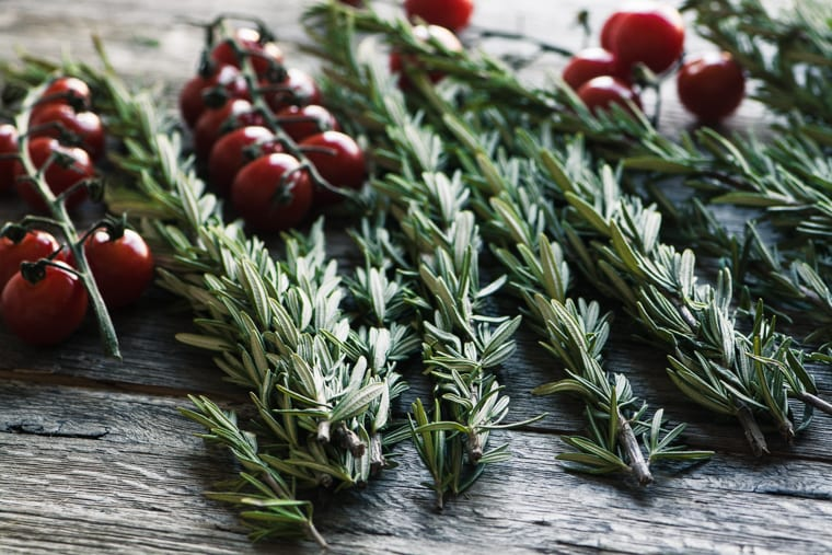 Fresh rosemary with cherry tomatoes