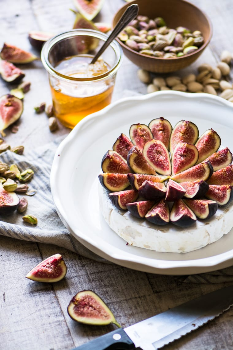 Figs on top of a wheel of Brie