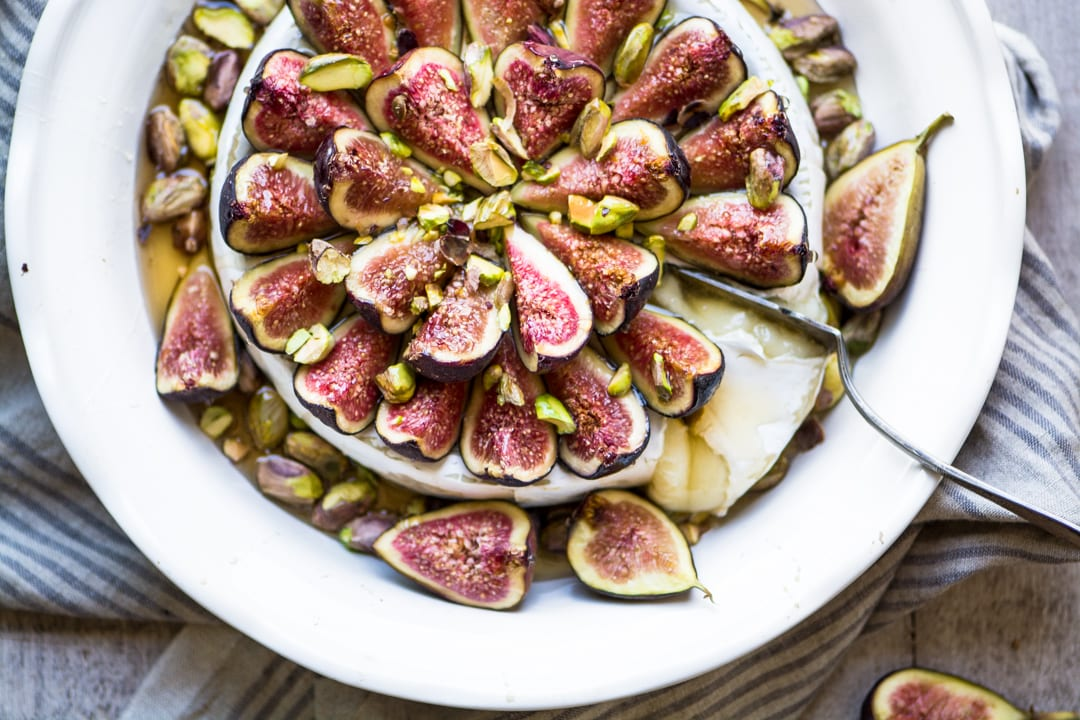Easy Bake Brie with Figs and Honey on a white plate