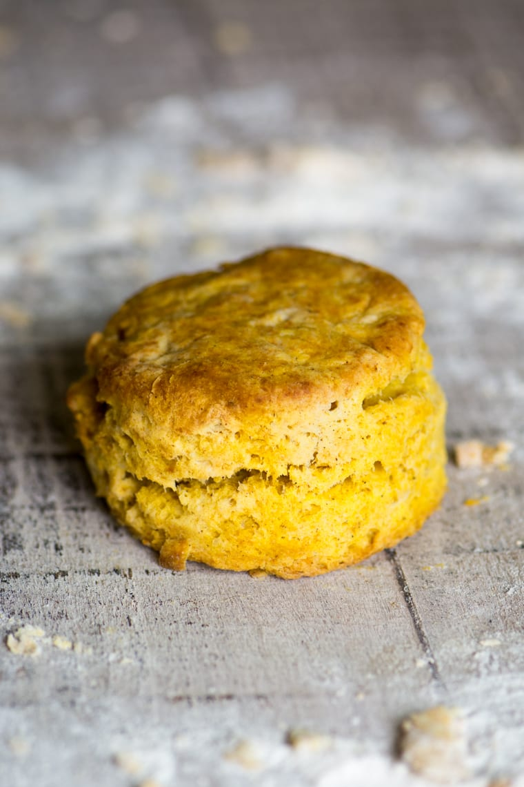 a pumpkin spice biscuit on a wooden table