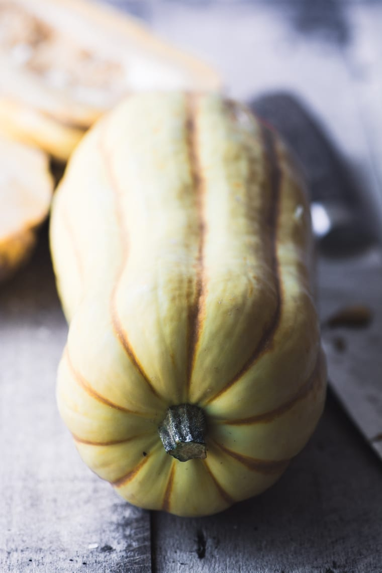 How to Roast Squash Seeds ~ five ways! ~ a winter squash on a table with chef's knife
