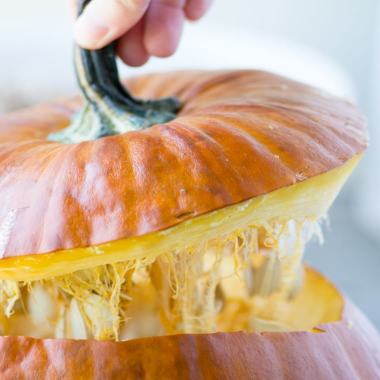 removing the top from a fresh pumpkin