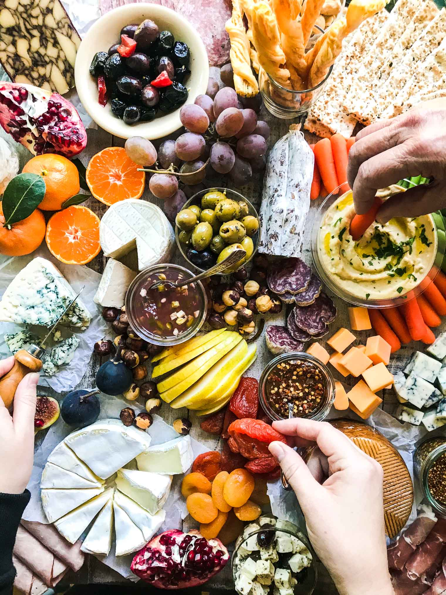 How to Make the Ultimate Cheeseboard with fruits, nuts, hummus, cheeses, meats, and more!