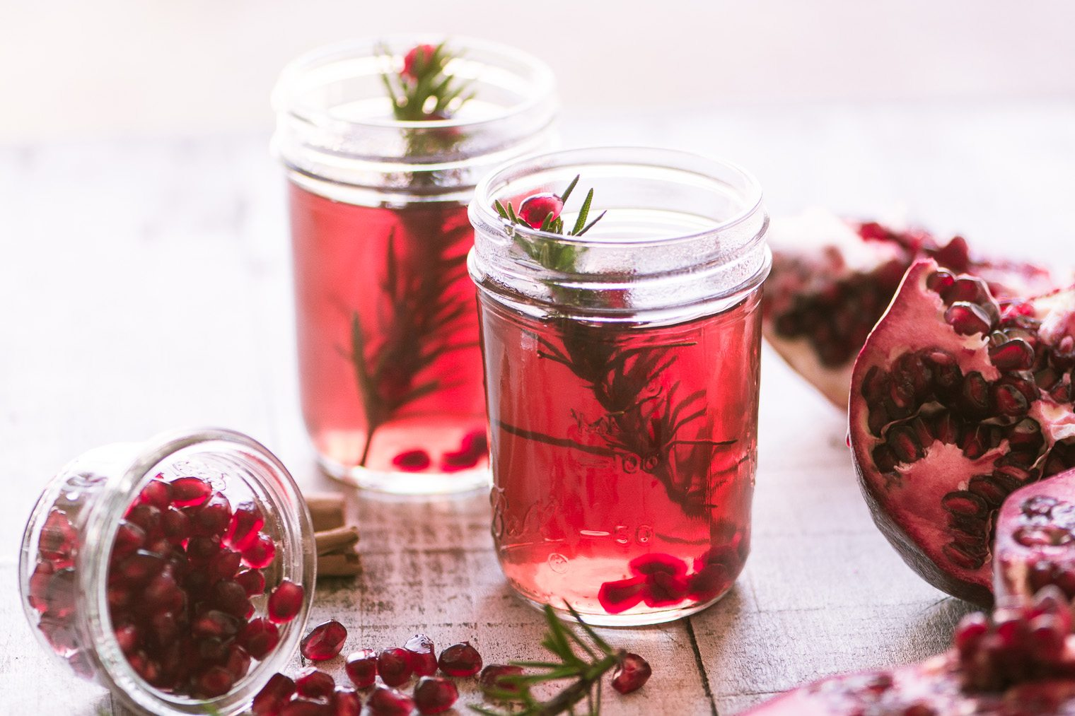 Non-alcoholic mulled pomegranate cider in mason jars