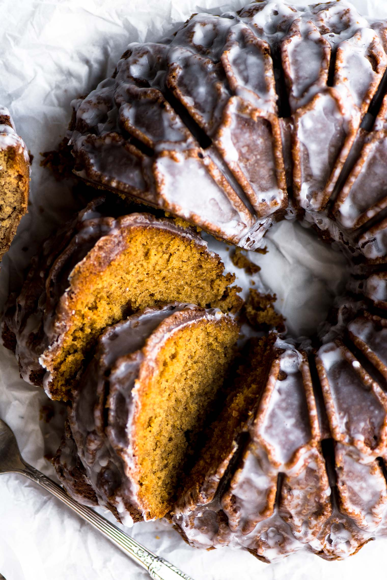 Glazed Gingerbread Bundt Cake, partially sliced