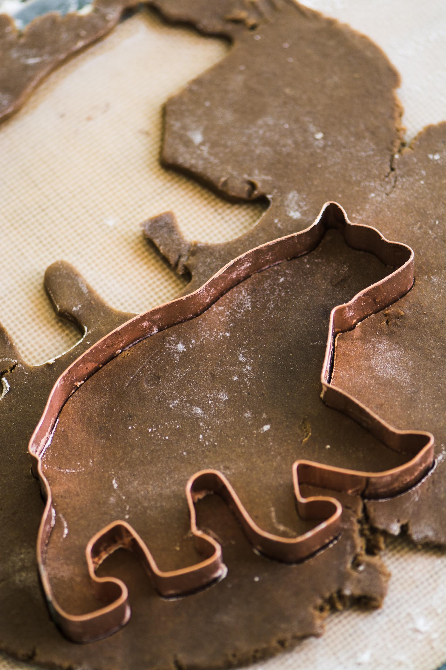 cutting out gingerbread cookie dough